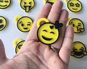 3D-printed smiley face pins